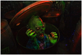 Photo of a zombie popping out of a toxic waste container